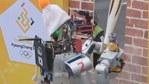 En Corée du Sud, un robot a porté la flamme olympique